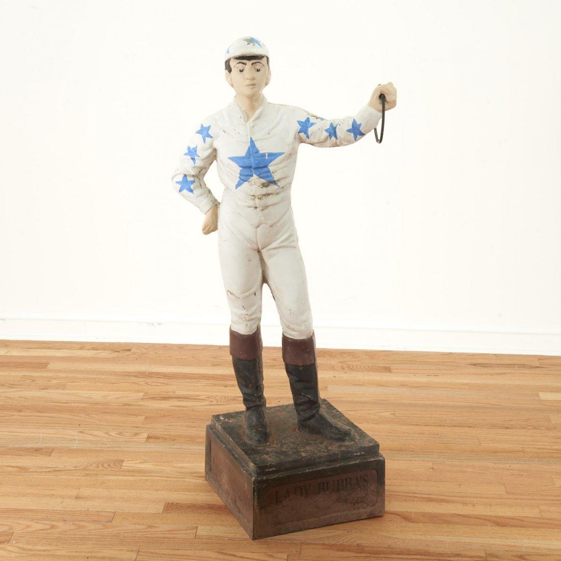"Antique cast metal ""horse racing"" lawn jockey"