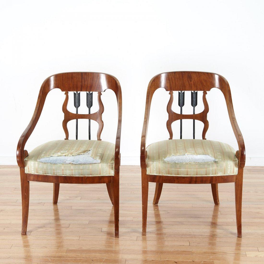 Pair Empire style parcel ebonized walnut armchairs