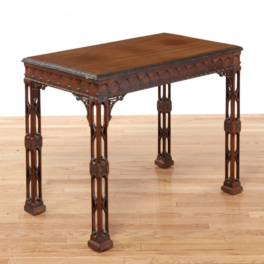 Gothic Revival carved mahogany side table