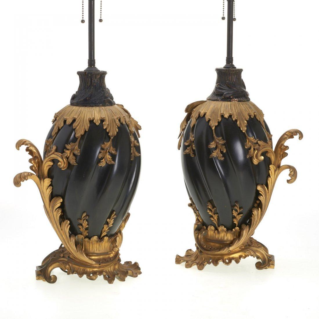 Pr Continental Rococo gilt, ebonized bronze lamps