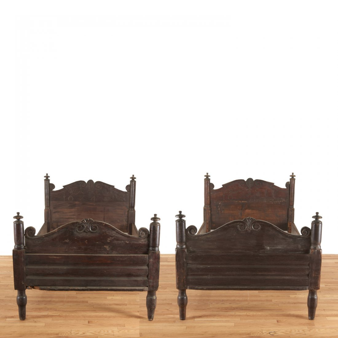 Pair Italian Baroque carved oak beds