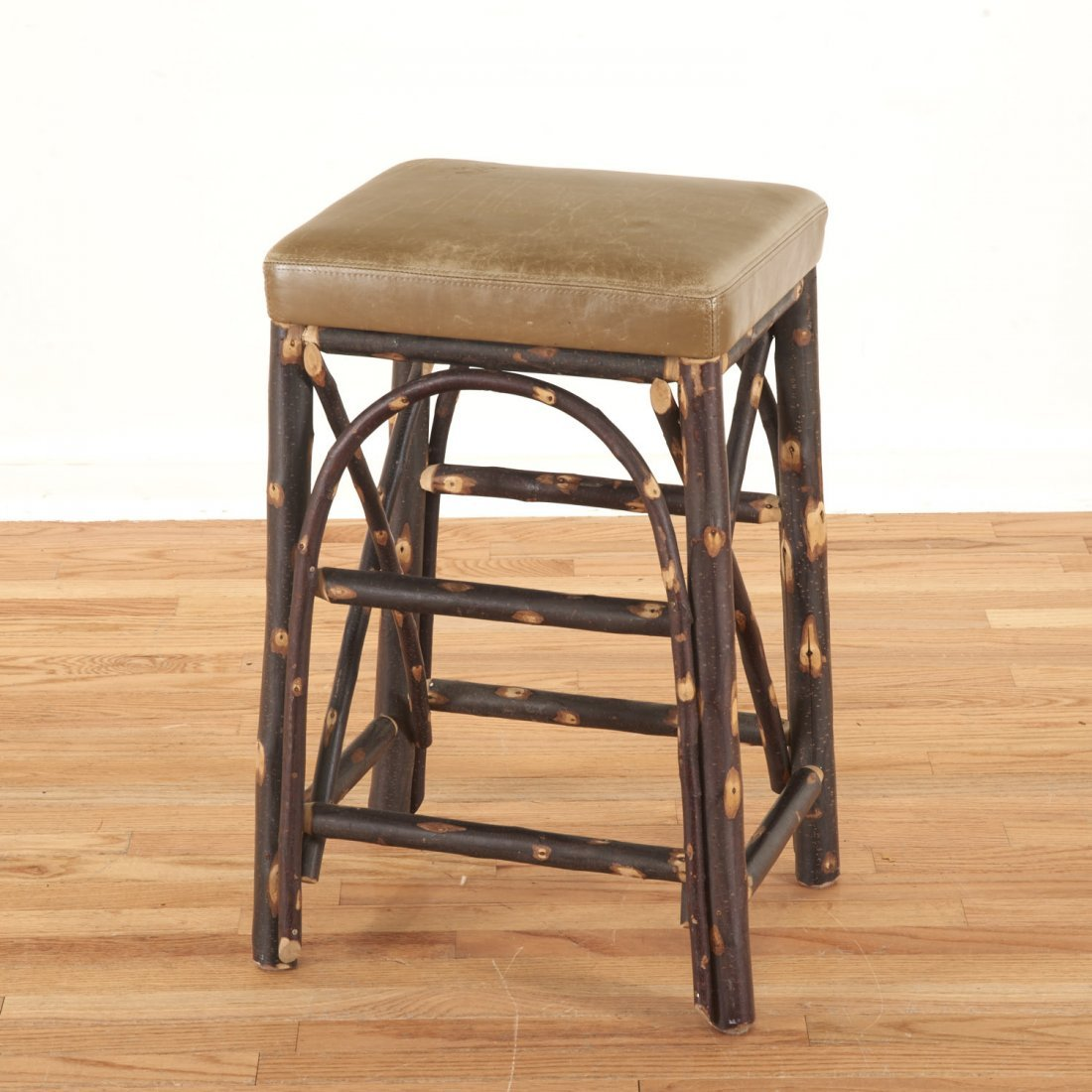 Christian Liaigre leather, chestnut stool