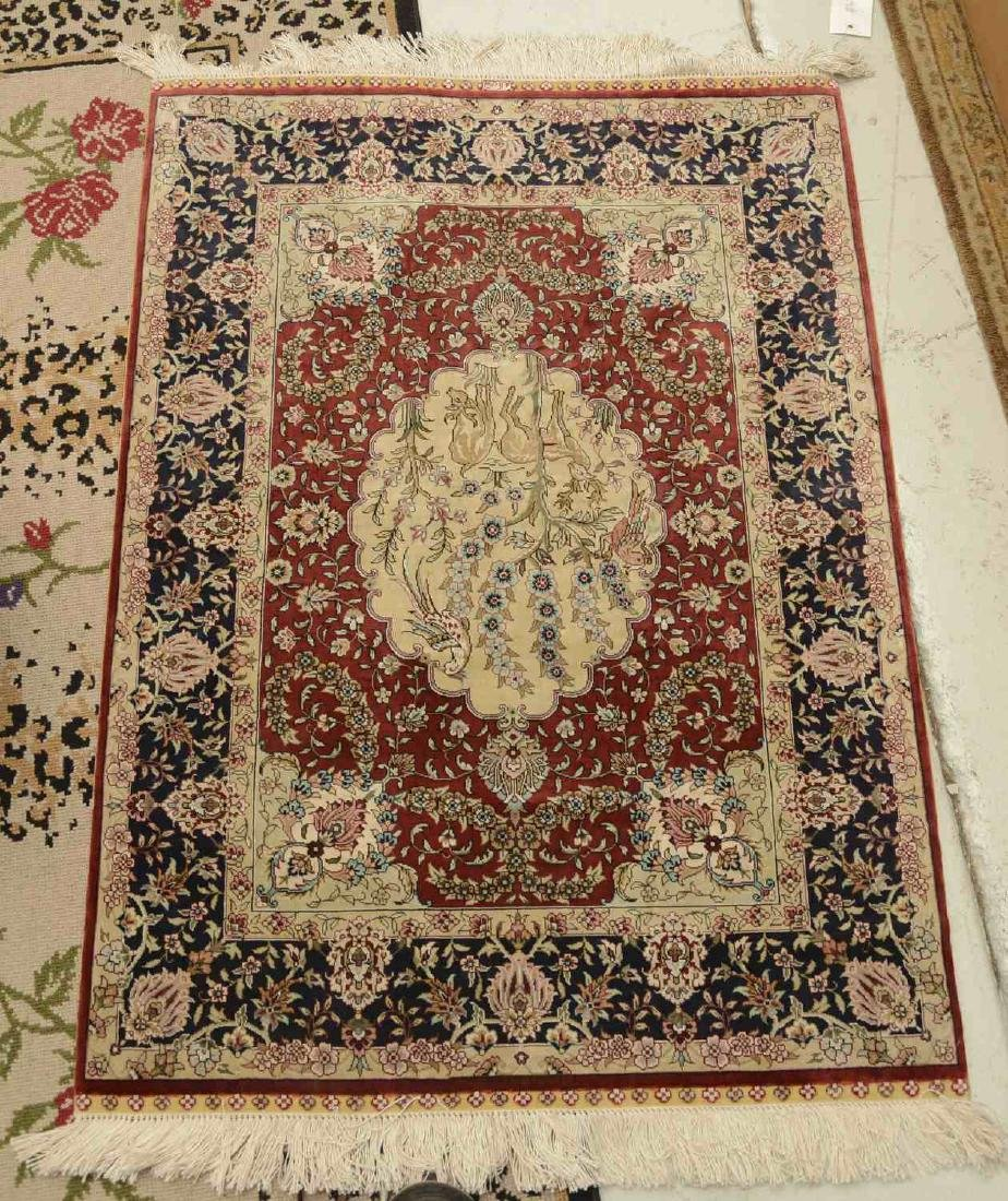 Persian silk rug with signature