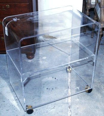 LUCITE TV STAND ON WHEELS