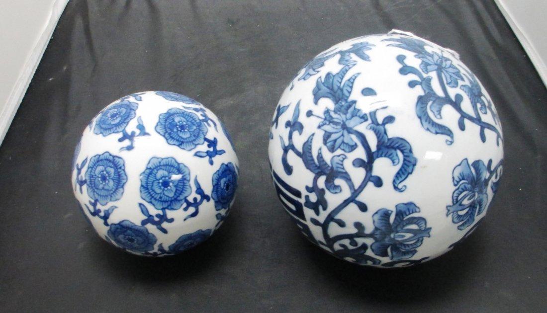 PAIR OF BLUE & WHITE PORCELAIN BALLS Japanese Floral