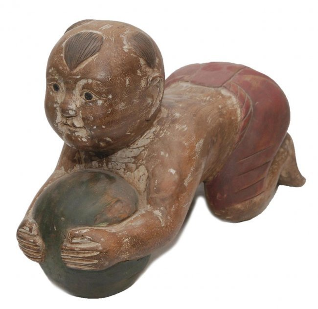 REPUBLIC PERIOD WOOD CARVING OF A CHINESE BOY