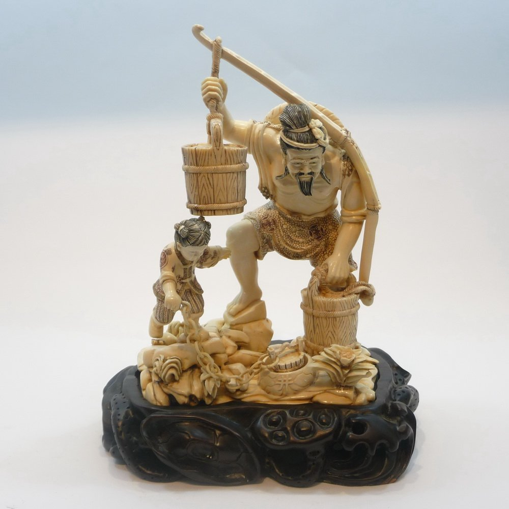 Mammoth Ivory Carvings - Father & Son Bringing water
