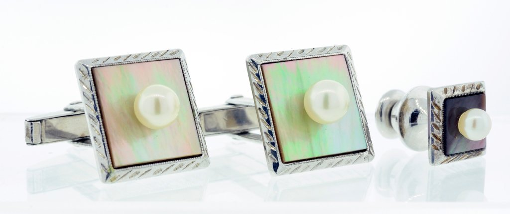 A SET OF SILVER, IRIDESCENT MOTHER OF PEARL, AND PEARL