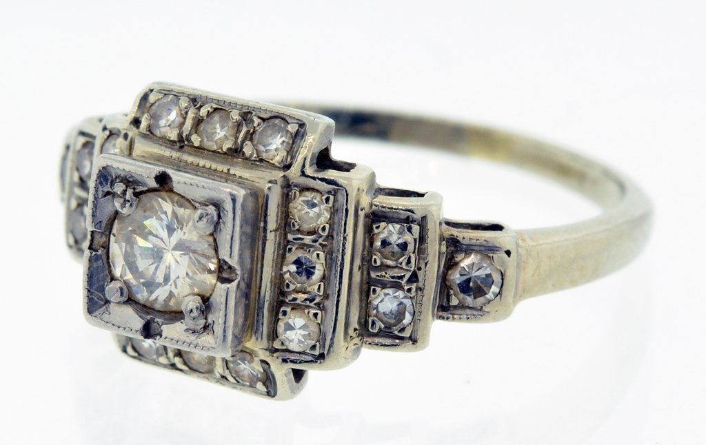 A LADIES ANTIQUE VICTORIAN STYLE 14KT GOLD AND DIAMOND