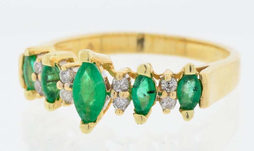 A LADIES 14 KT YELLOW GOLD, MARQUIS EMERALD, AND ROUND