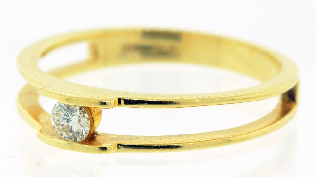 A LADIES 18 KT YELLOW GOLD DUAL BAND BEZEL SET DIAMOND