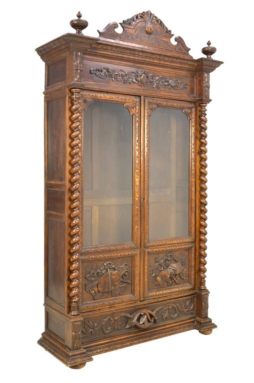 AN ITALIAN VICTORIAN STYLE CARVED WALNUT TWO DOOR BOOKC