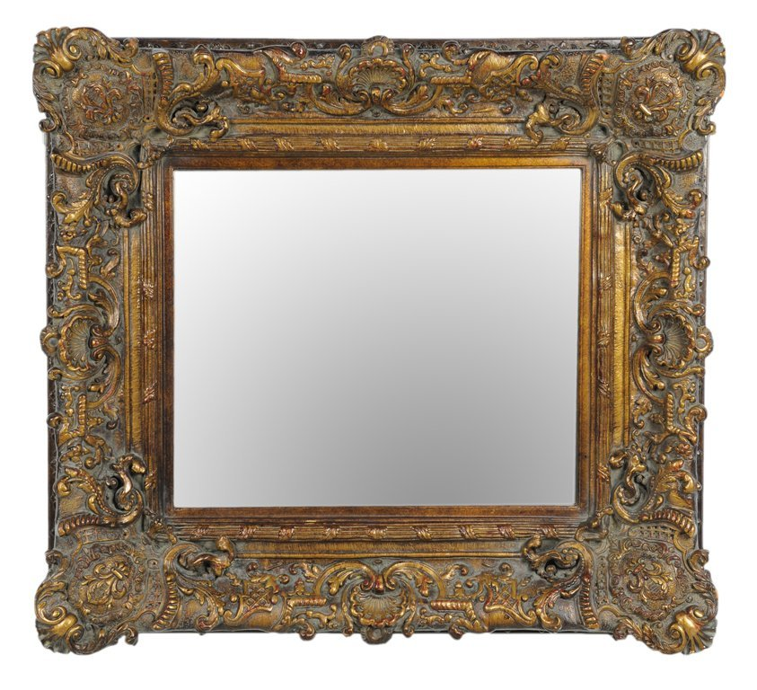 A LOUIS XVI STYLE MIRROR WITH BRONZE FINISH