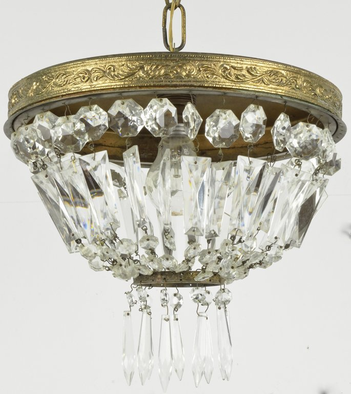 A PAIR OF LOUIS XVI STYLE BRASS AND CRYSTAL SINGLE LIGH