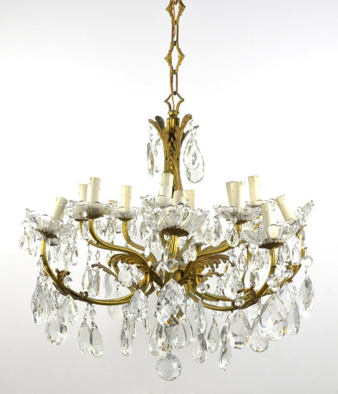 A LOUIS XVI STYLE GILDED AND CRYSTAL 16-LIGHT CHANDELIE
