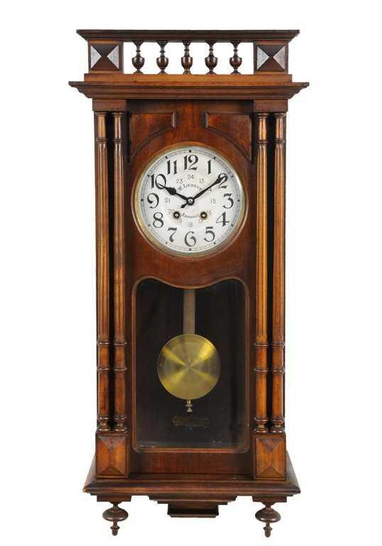 A Henri Ii Style Pendulum Wall Clock