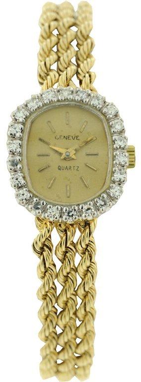A LADIES 14KT YELLOW GOLD AND DIAMOND 'GENEVE' QUARTZ W