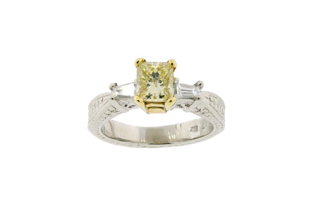 A PLATINUM, 18KT YELLOW GOLD, FANCY YELLOW DIAMOND RING