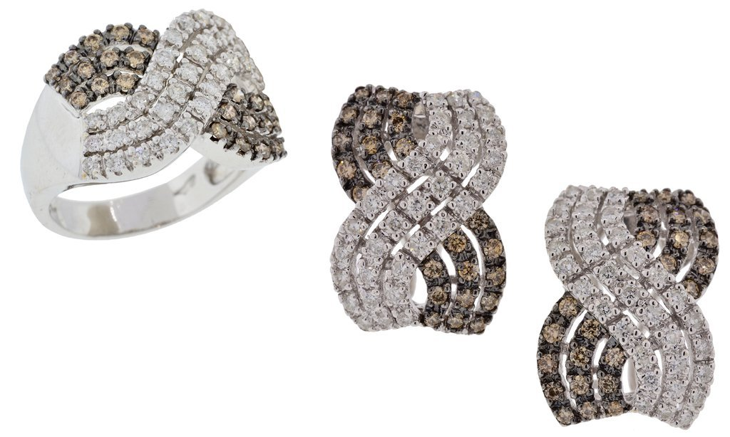 A SET OF 14KT WHITE GOLD DIAMOND RING AND EARRINGS