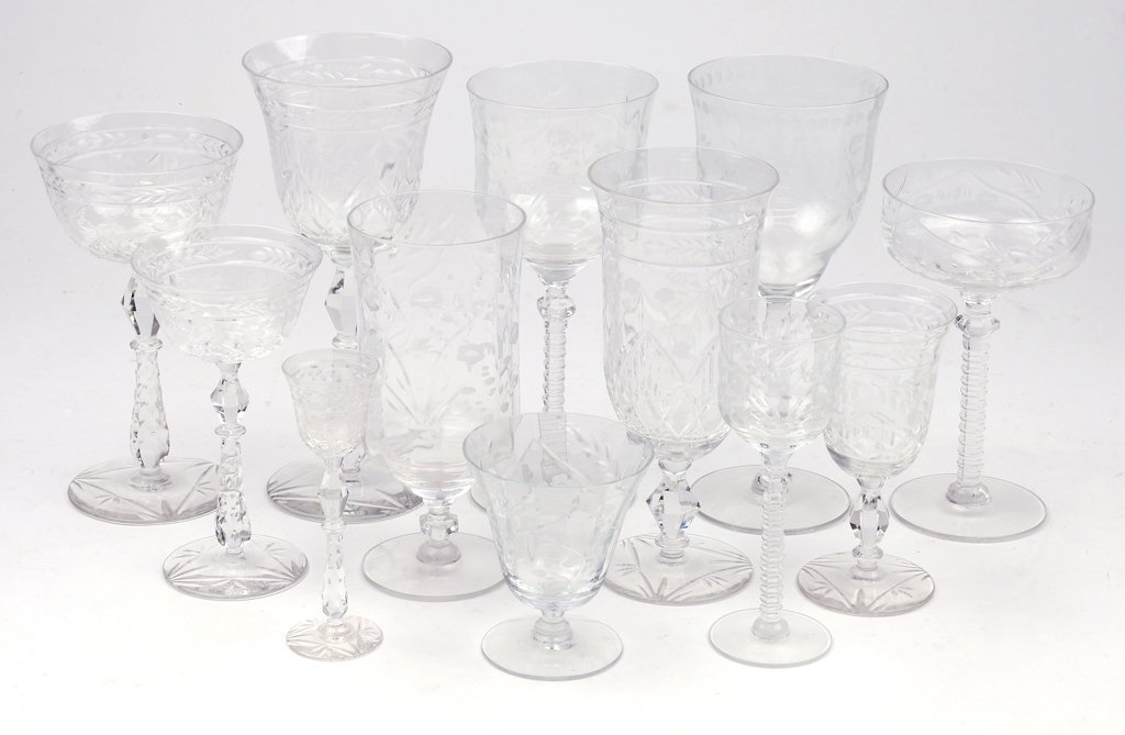 A COLLECTION OF LAUREL LEAF CRYSTAL AND ETCHED GLASS ST