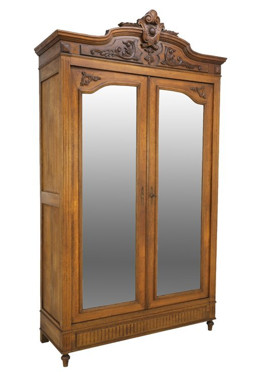 A LOUIS XVI STYLE ARMOIRE WITH CABOCHON MEDALLION