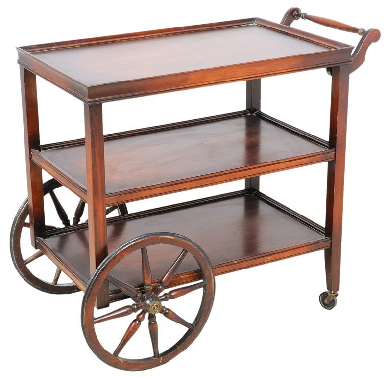 A VINTAGE ROLLING SERVING CART WITH WAGON WHEELS
