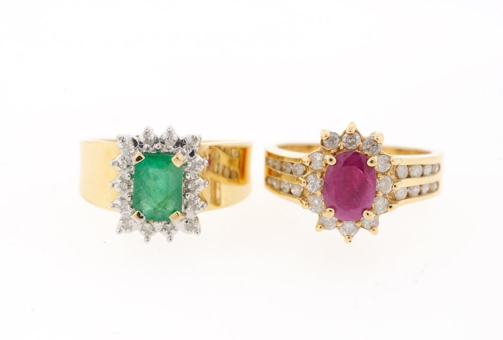 A PAIR OF RUBY AND EMERALD RINGS