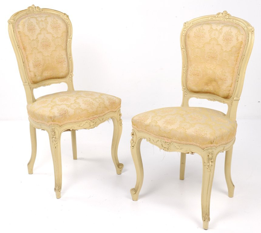 AN ANTIQUE CRÉME LOUIS XV STYLE PAIR OF SALON SIDE CHAI