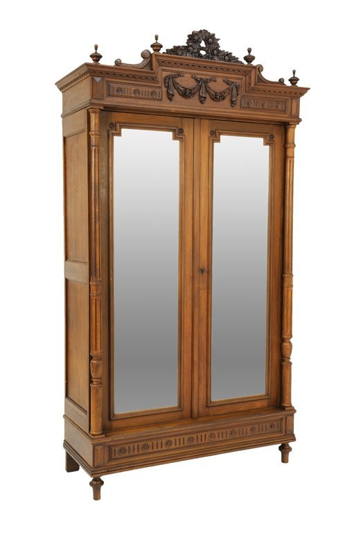 A NEOCLASSICAL STYLE OAK ARMOIRE WITH WREATH AND FESTOO