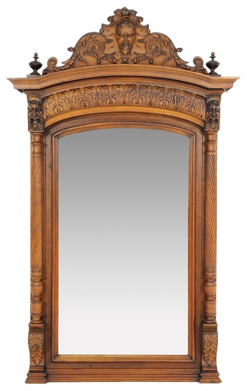 A WALNUT FINISH RENAISSANCE REVIVAL STYLE MIRROR WITH G