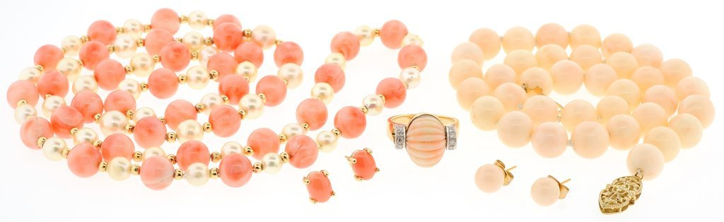 A GROUP OF CORAL NECKLACES AND RING