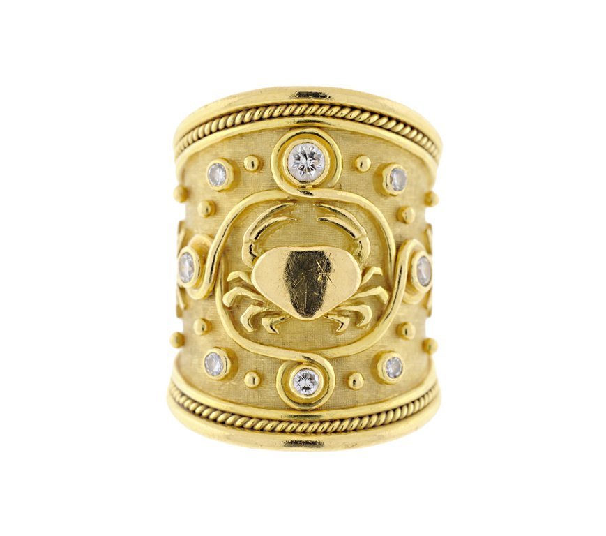 AN 18KT GOLD AND DIAMOND ASTROLOGICAL RING BY ELIZABETH