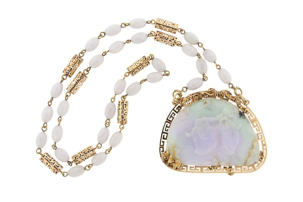 A FINE NATURAL JADEITE AND 14KT GOLD PENDANT AND
