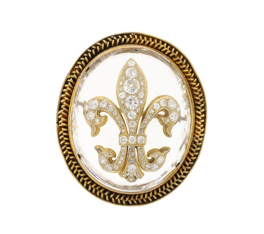 A CRYSTAL AND DIAMOND FLEUR DE LIS PENDANT PIN IN 14KT