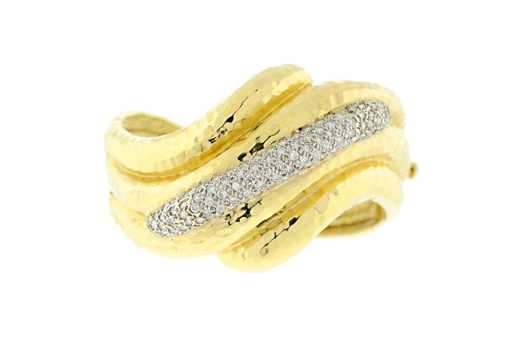 A VINTAGE GOLD BANGLE BRACELET BY MITCHELL ROTKEL Very