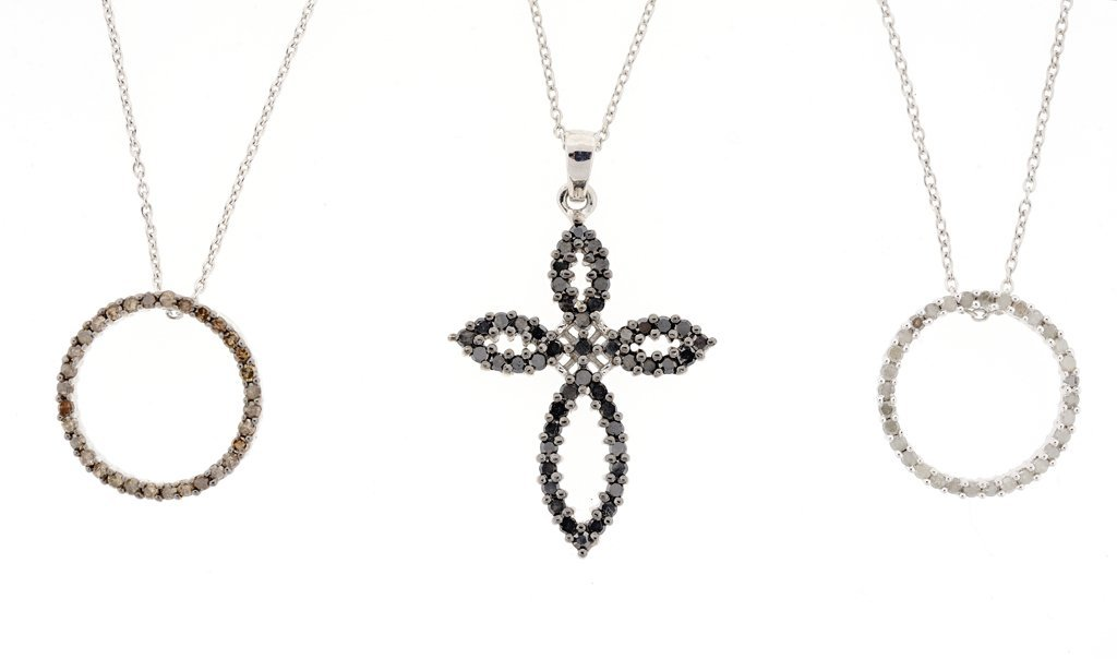 A GROUP OF DIAMOND PENDANTS AND CHAIN IN STERLING