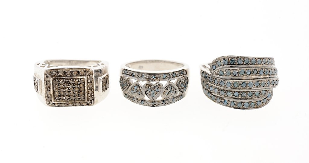 A GROUP OF THREE DIAMOND AND STERLING SILVER RINGS