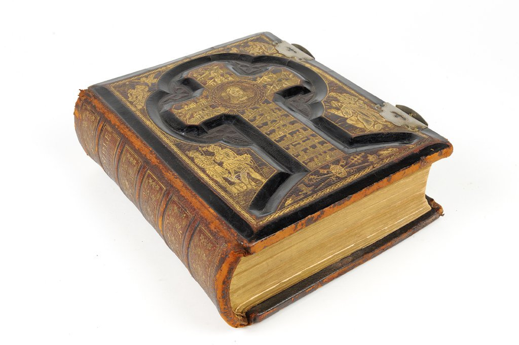 AN EMBOSSED LEATHER BOUND 19TH CENTURY FAMILY BIBLE