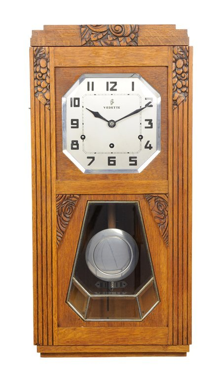 """AN ART DECO STYLE """"VEDETE"""" CLOCK WITH ROSES"""
