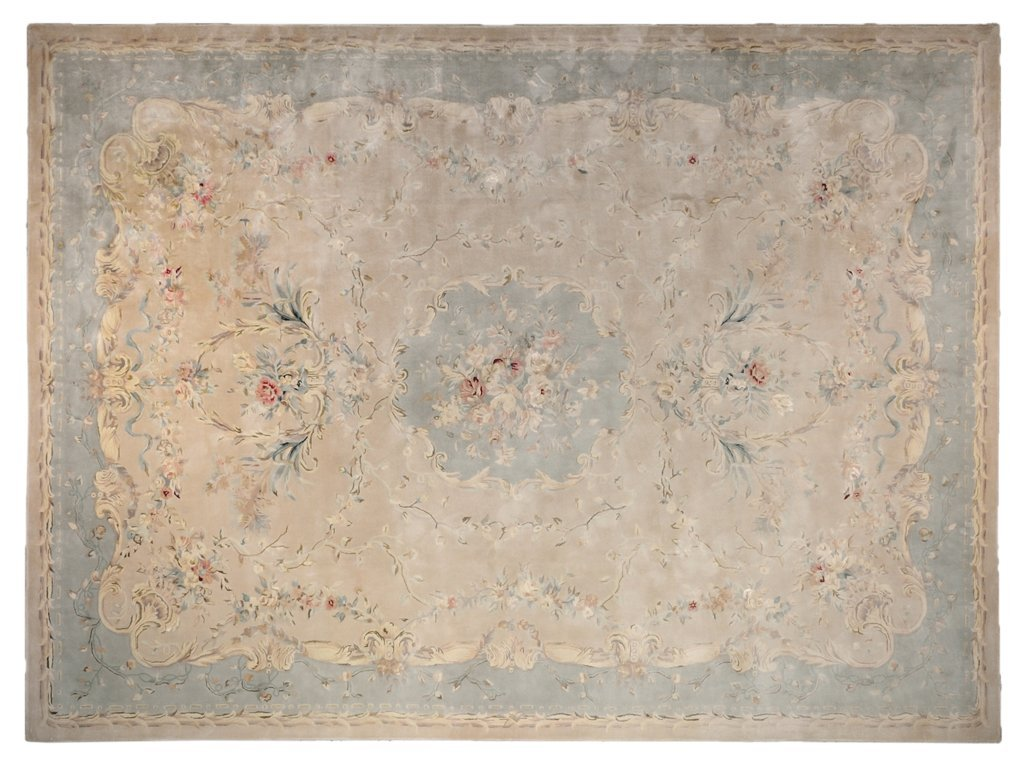 A FRENCH TUFTED AUBUSSON RUG IN CRÈME AND BLUE