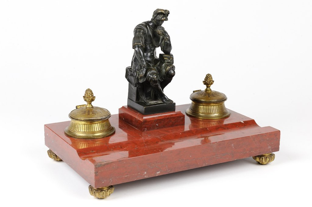 A NEOCLASSICAL ROMAN STYLE INK WELL ON RED MARBLE STAND