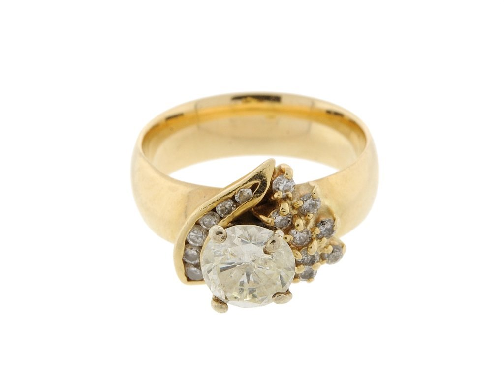 A 14KT YELLOW GOLD AND 1.50CTS DIAMOND RING