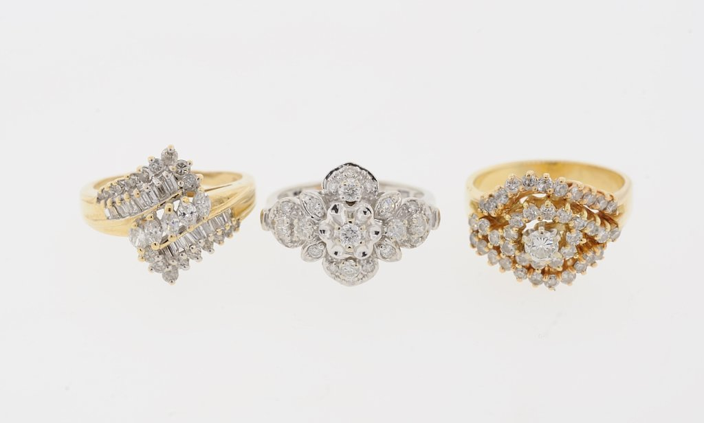 A GROUP OF 10KT AND 14KT GOLD AND DIAMOND RINGS