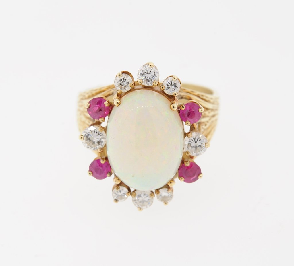 A LADIES 14KT YELLOW GOLD OPAL, DIAMOND AND RUBY RING