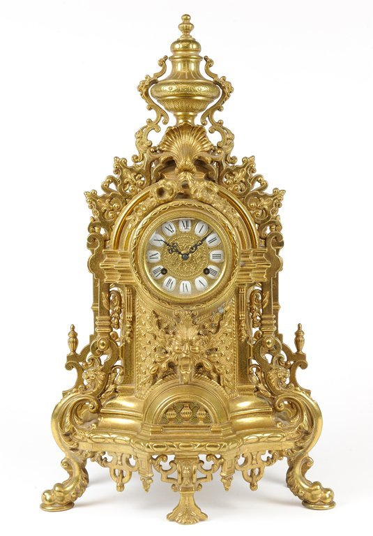 A ROCOCO REVIVAL STYLE MANTLE CLOCK URN TOP AND