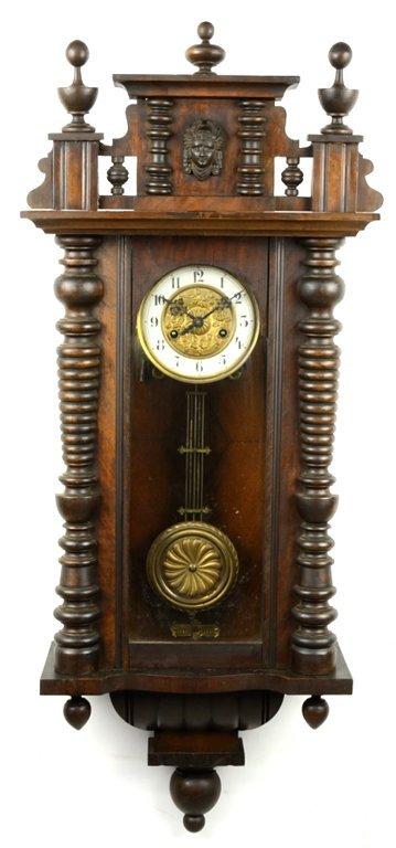 AN ANTIQUE PENDULUM WALL CLOCK WITH MINERVA, FINIALS,