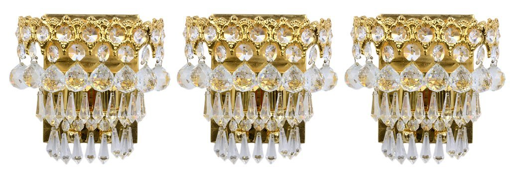 A SET OF THREE CRYSTAL AND GILT TONE SCONCE LIGHTING