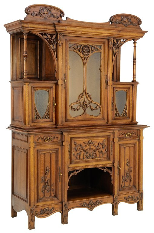 A LATE GOTHIC VICTORIAN REVIVAL STYLE SIDEBOARD IN A
