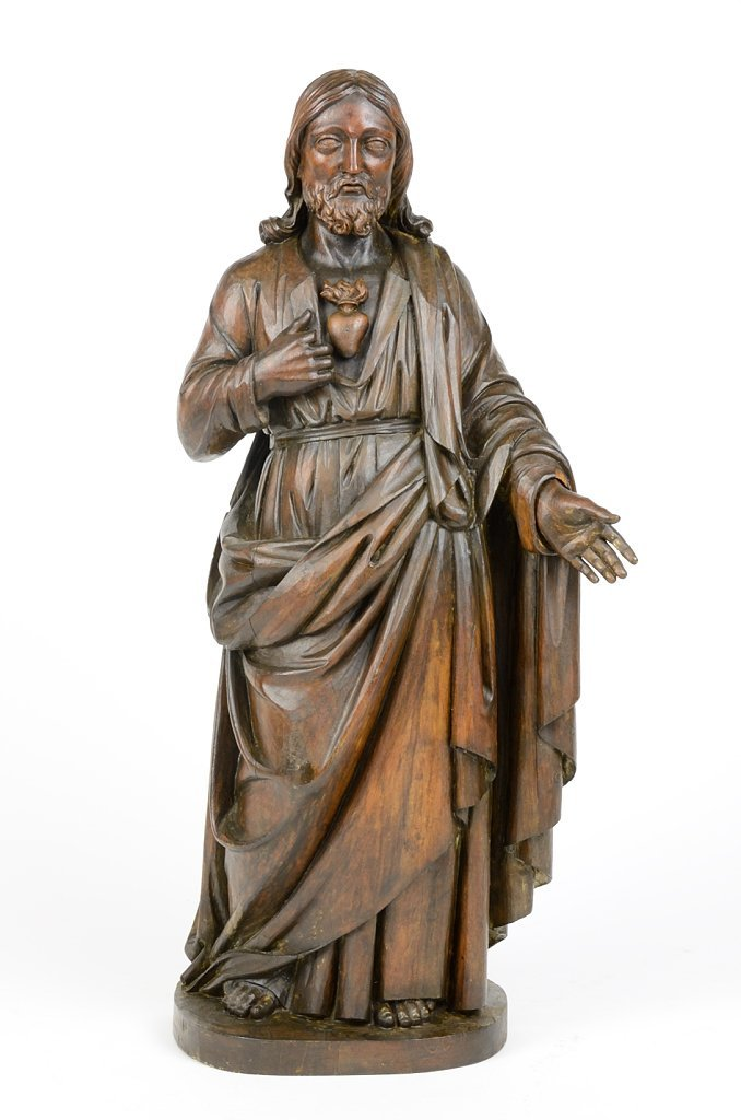 A CARVED WOOD FIGURE OF CHRIST WITH SACRED HEART