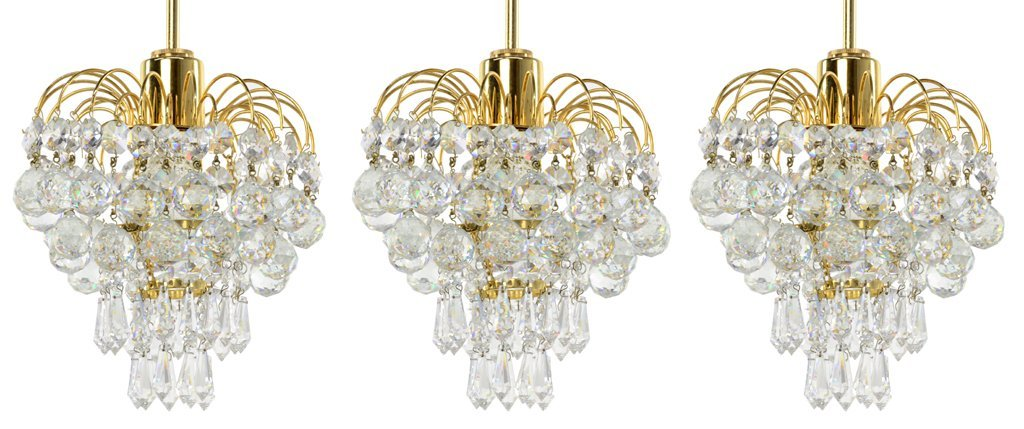A TRIO OF CLUSTERED CRYSTAL AND GILT TONE LIGHTING